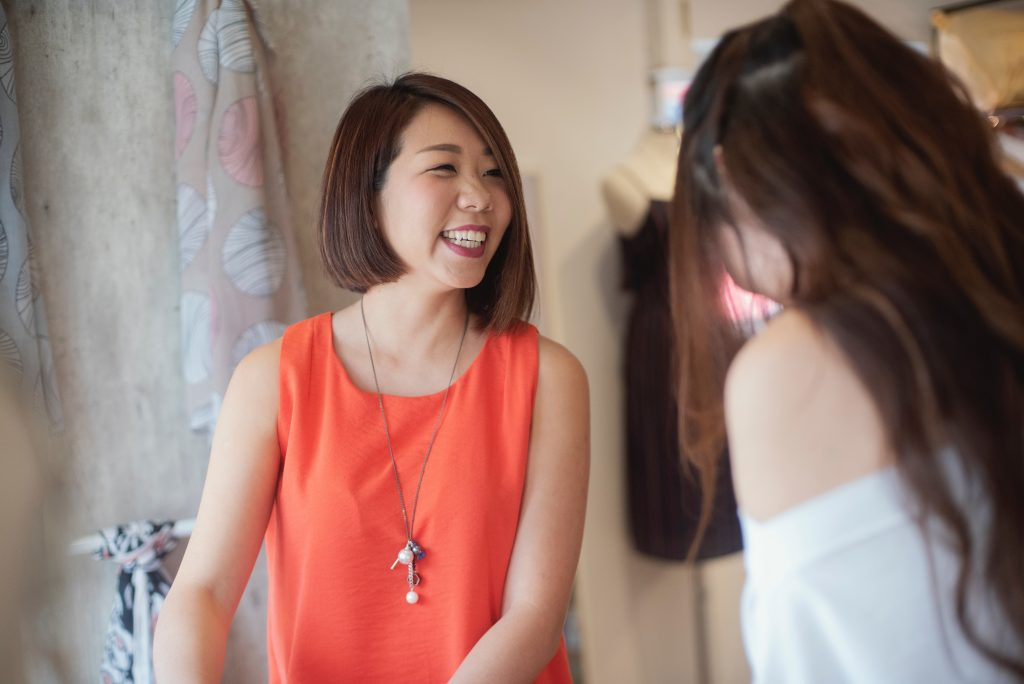 A seamstress and a client in conversation